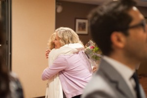 Bea Rhodes, President of Rhodes College, embraces an alumnus at the 20th Anniversary Alumni Reunion